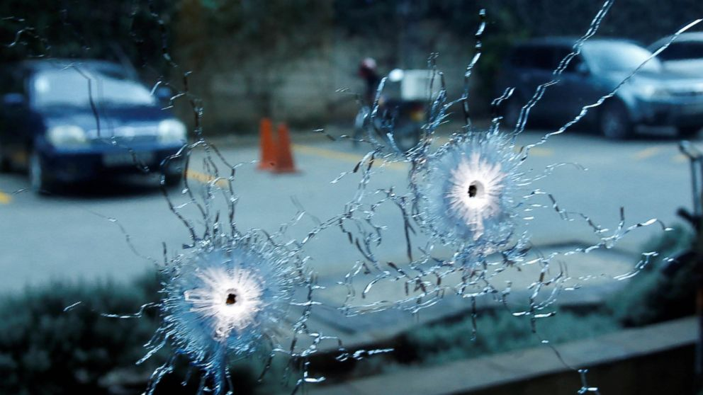 A glass damaged by bullets is seen at the scene where explosions and gunshots were heard at the Dusit hotel compound, in Nairobi, Kenya, Jan. 15, 2019.
