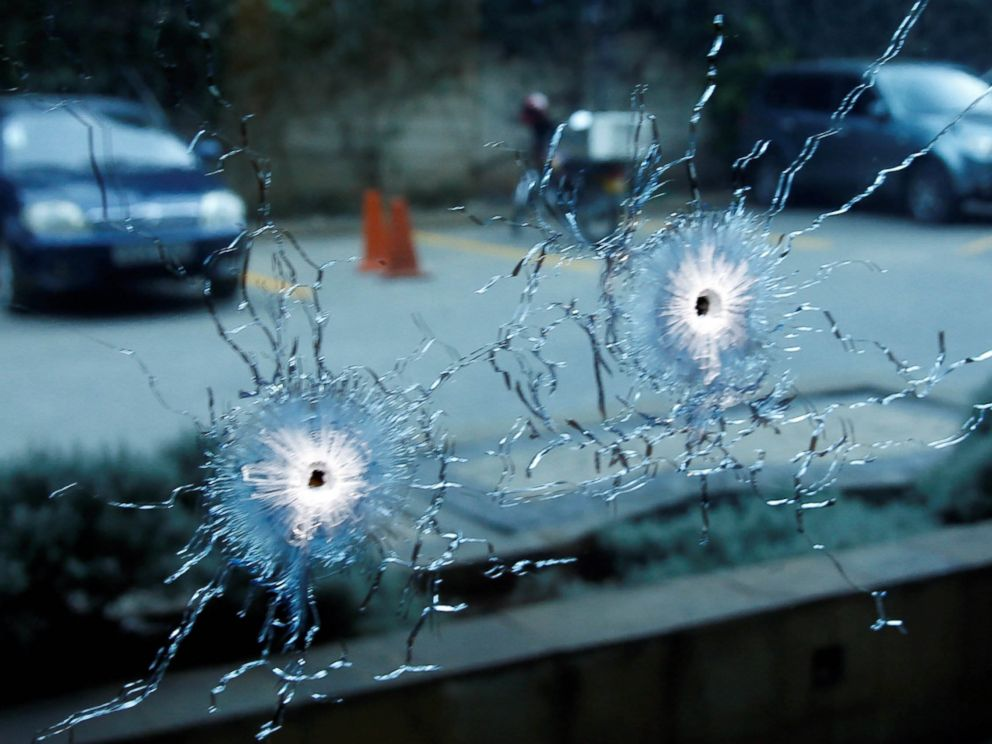 PHOTO: A glass damaged by bullets is seen at the scene where explosions and gunshots were heard at the Dusit hotel compound, in Nairobi, Kenya, Jan. 15, 2019.