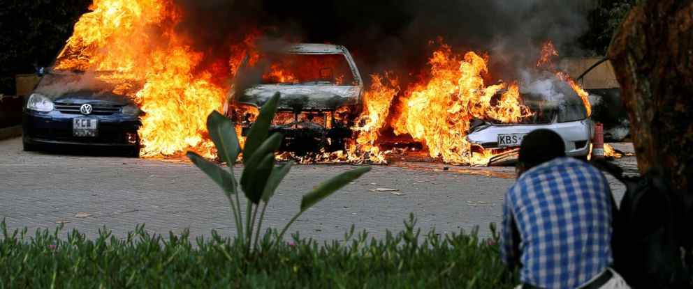 PHOTO: Cars are seen on fire at the scene of explosions and gunshots in Nairobi, Kenya, Jan. 15, 2019.