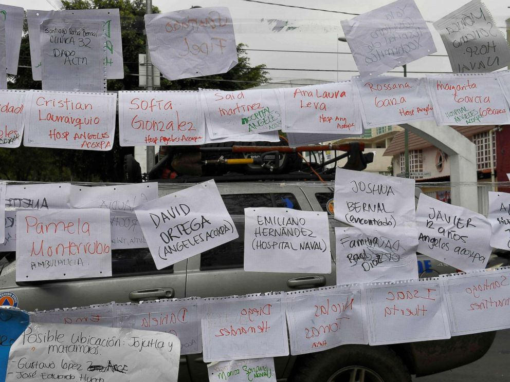 PHOTO: Sheets of paper display names and lists of people and the hospitals they are in, near a school where at least 21 children died and 30 are missing in Mexico City on Sept. 20, 2017.