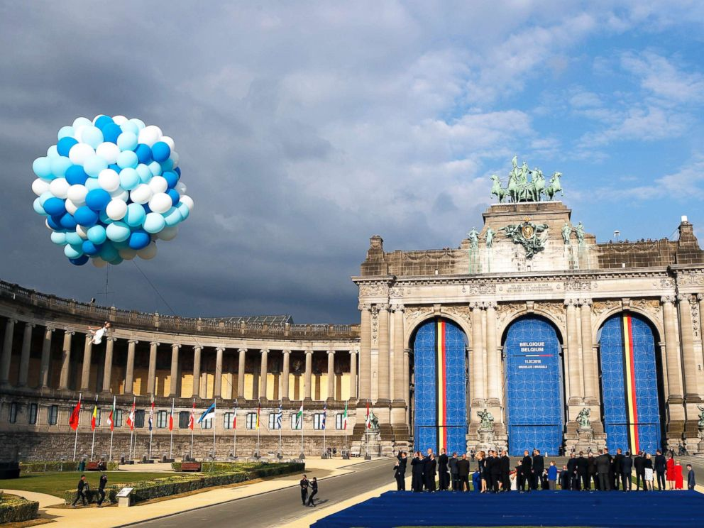 PHOTO: A dancer performs under balloons during a group photo of NATO heads of state and government at Park Cinquantenaire in Brussels, July 11, 2018.