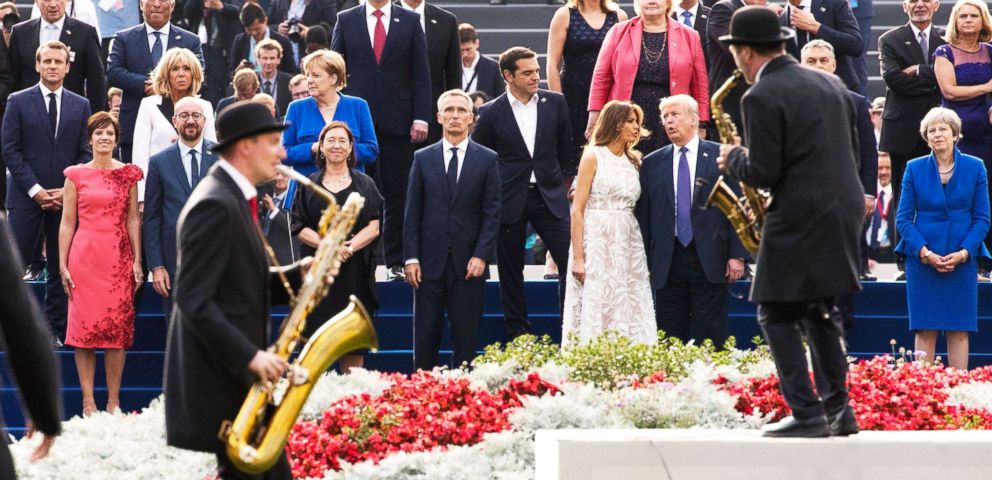 PHOTO: Dignitaries watch a show fter a dinner at the Parc du Cinquantenaire - Jubelpark park in Brussels, July 11, 2018.