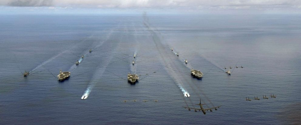 PHOTO: USS Nimitz (CVN 68), USS Kitty Hawk (CV 63), and USS John C. Stennis (CVN 74) carrier strike groups steam in formation during a joint photo exercise (PHOTOEX) during exercise Valiant Shield Aug. 14, 2007.