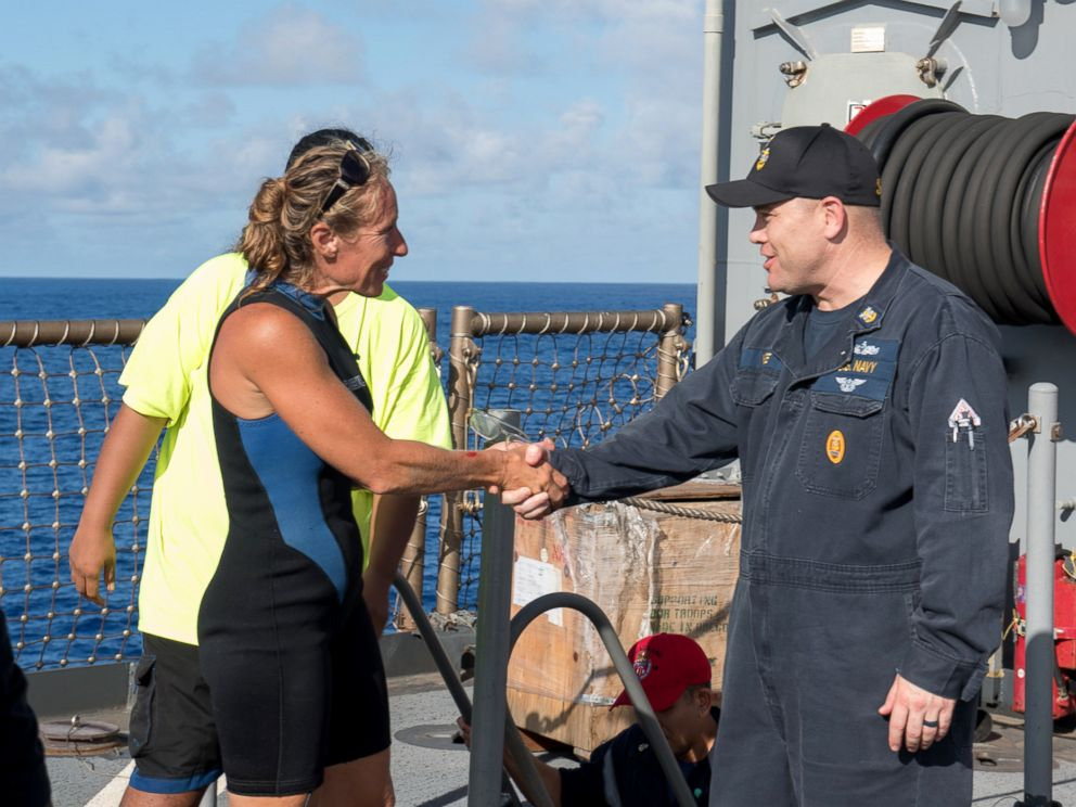 PHOTO: USS Ashland (LSD 48) Command Master Chief Gary Wise welcomes aboard Jennifer Appel, an American mariner who had received assistance from Ashland crew members, Oct. 25, 2017.