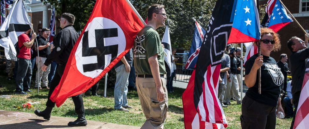 """PHOTO: A white nationalist carries the Nazi flag during a """"Unite the Right"""" rally in Charlottesville, Va., Aug. 12, 2017."""