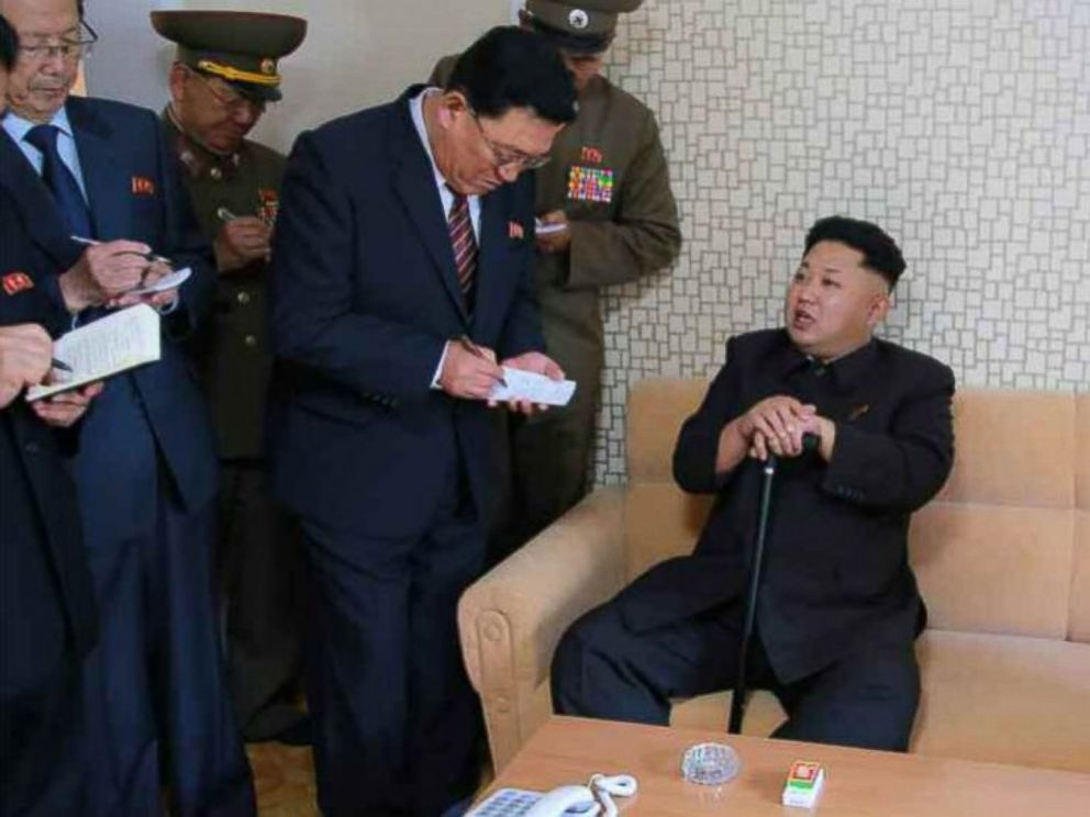 PHOTO: A photo released by North Koreas official news agency on Oct 14, 2014 shows North Korean leader Kim Jong-un using a cane during his first public appearance in weeks.