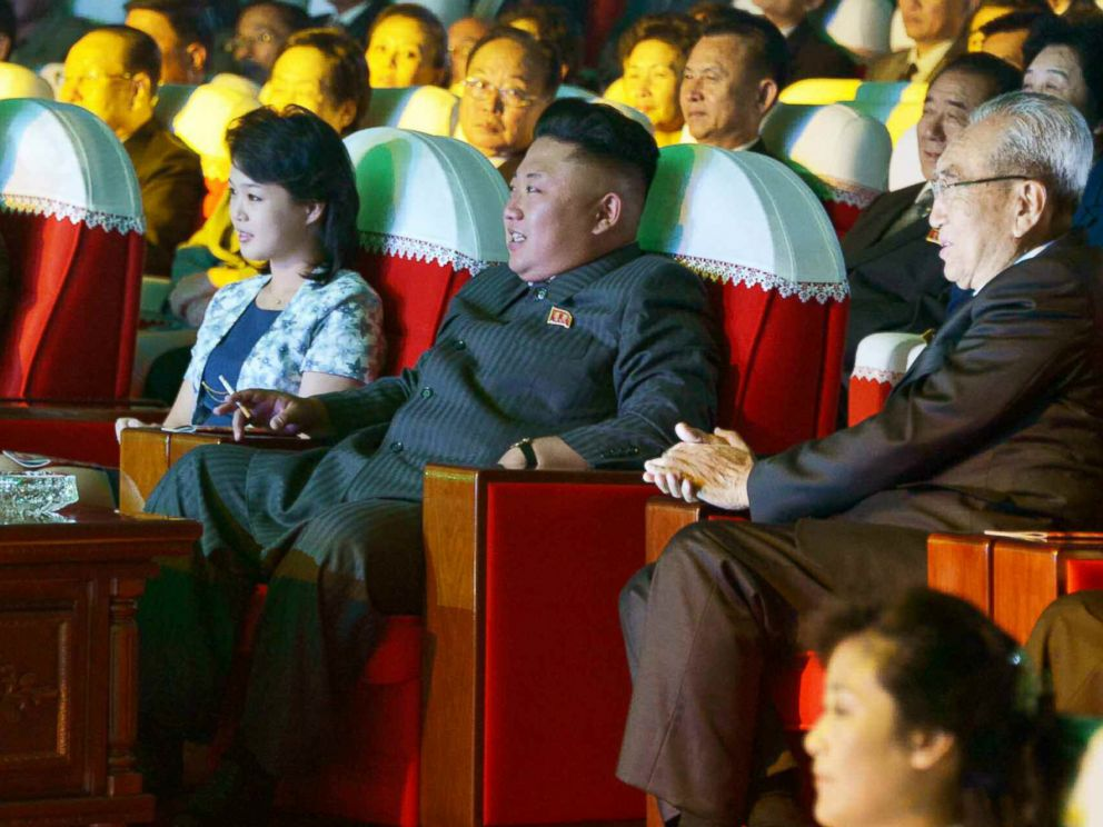 PHOTO: North Korean leader Kim Jong-un and his wife, Ri Sol-ju, watch a performance by the Moranbong Band in Pyongyang on Sept. 3, 2014.
