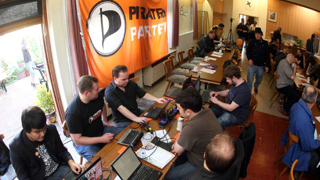 PHOTO: Delegates of the Pirate Party sit in front of their computers at the third state party meeting in Anderbach, Germany, Oct. 2, 2011.