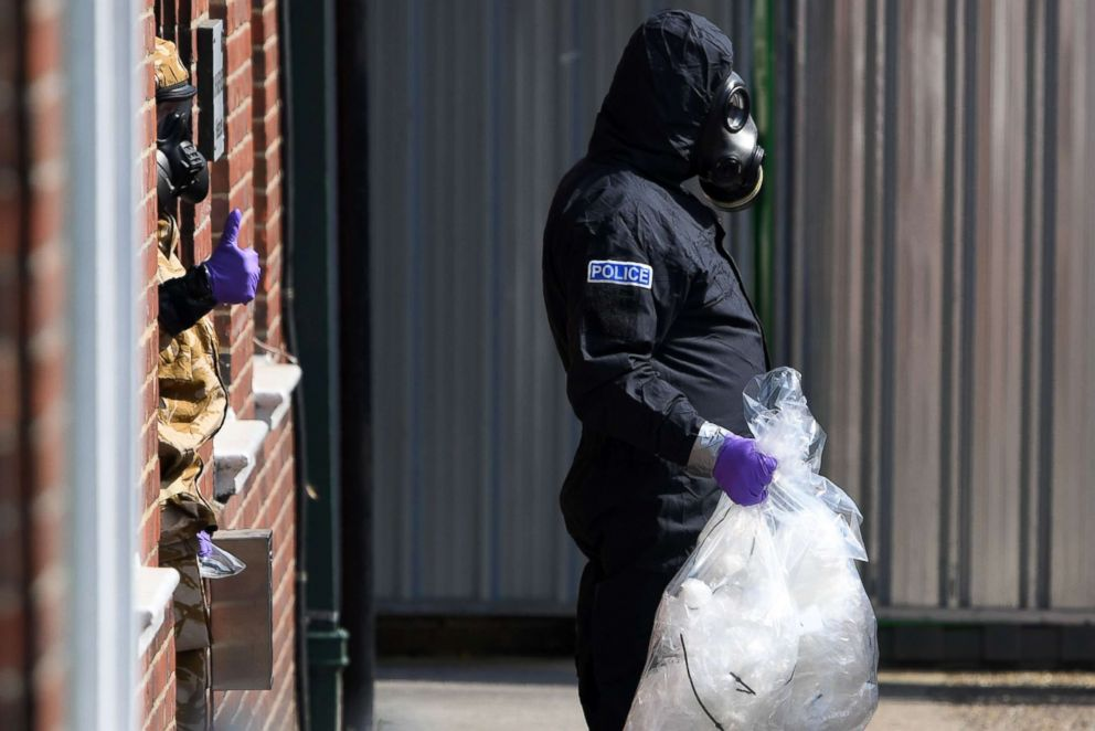 PHOTO: Investigators wearing protective suits, gloves and gas masks on Rollestone Street in Amesbury, southern England, July 6, 2018. The investigation is in connection with a British couple being exposed to the same toxin as a former Russian spy.