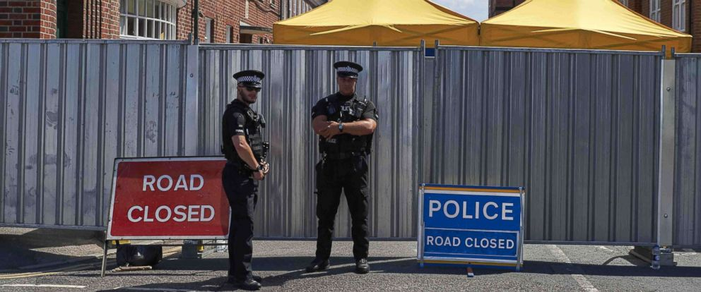 PHOTO: Police officers stand guard near barriers across Rollestone Street, outside the John Baker House Sanctuary Supported Living in Salisbury, southern England, July 8, 2018.