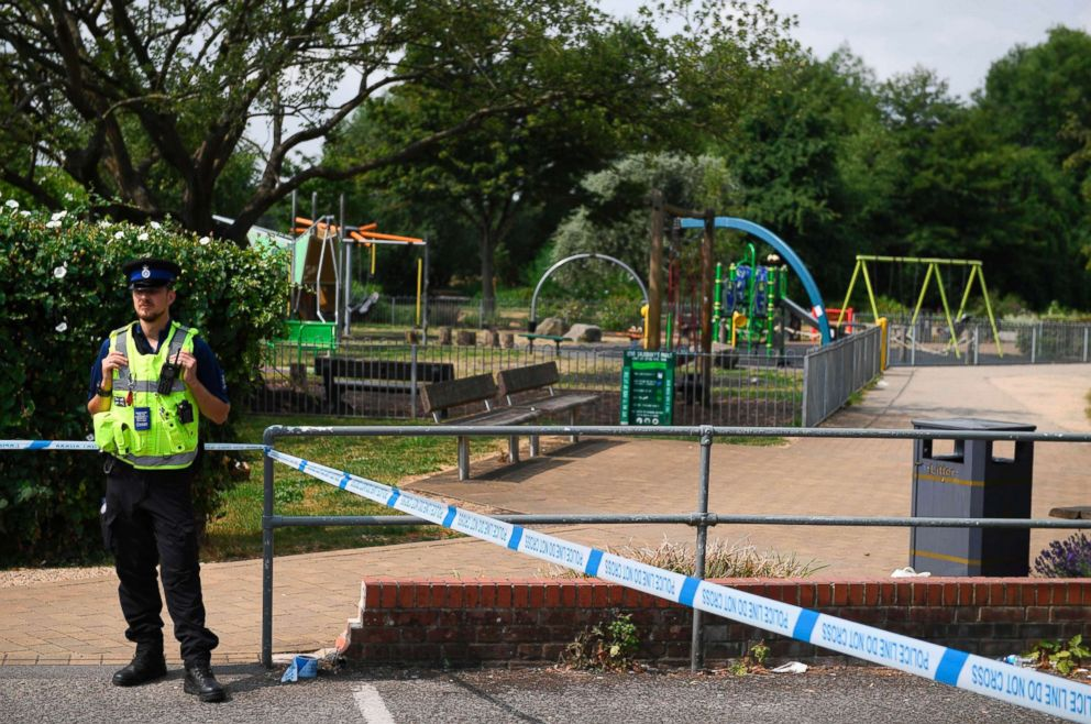 A police officer stands at a cordon by a play park at Queen Elizabeth Gardens in Salisbury, southern England, on July 5, 2018 cordoned off in connection with the investigation and major incident declared after a man and woman were found unconscious after exposure with what was later identified as the nerve agent Novichok.