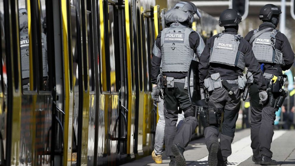 Police forces walk near a tram at the 24 Oktoberplace in Utrecht, March 18, 2019, where a shooting took place.