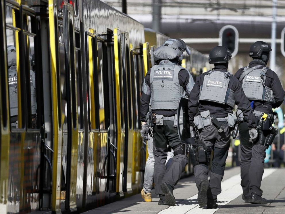 PHOTO: Police forces walk near a tram at the 24 Oktoberplace in Utrecht, March 18, 2019, where a shooting took place.