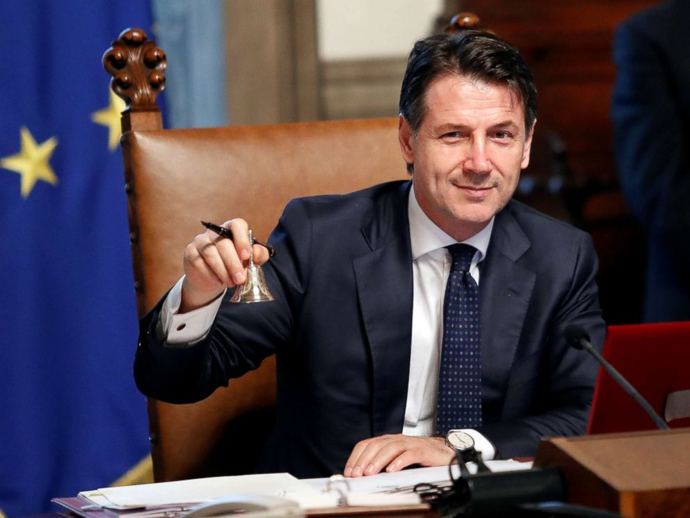 PHOTO: Newly appointed Italian Prime Minister Giuseppe Conte rings the bell during his first cabinet meeting at Chigi palace in Rome, June 1, 2018.