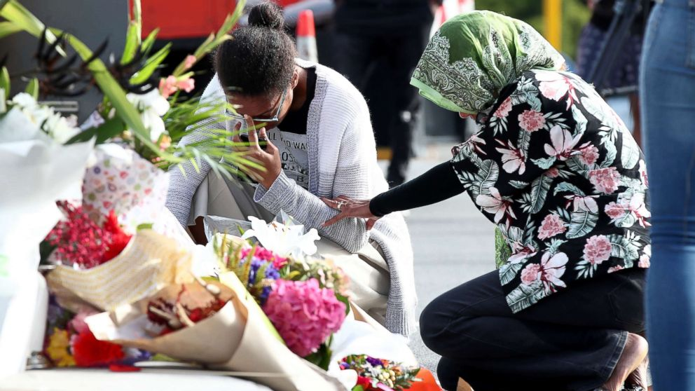 Locals lay flowers in tribute to those killed and injured at Deans Avenue near the Al Noor Mosque, March 16, 2019, in Christchurch, New Zealand.
