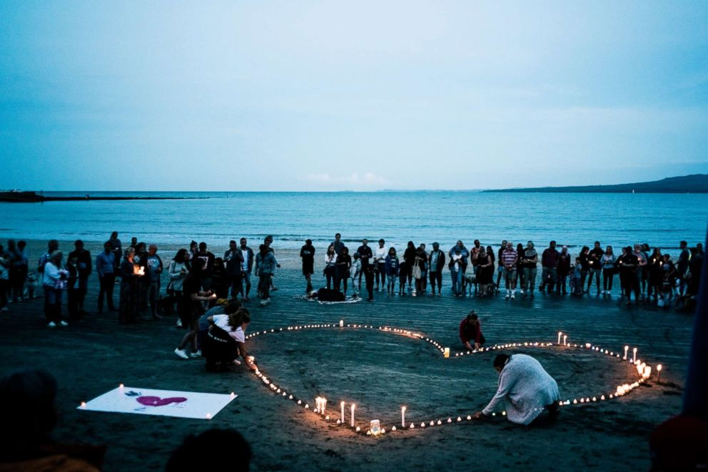 PHOTO: Crowds gather for a vigil in memory of the victims of the Christchurch mosque terror attacks, on Takapuna beach, March 16, 2019, in Auckland, New Zealand.