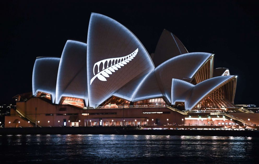 PHOTO: A silver fern is projected onto the sails of the Opera House in commemoration of the victims of the Christchurch massacre, March 16, 2019, in Sydney, Australia.