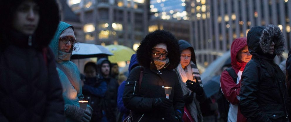 PHOTO: People gather for a vigil held for the victims of the New Zealand terror attack, March 15, 2019, in Toronto.