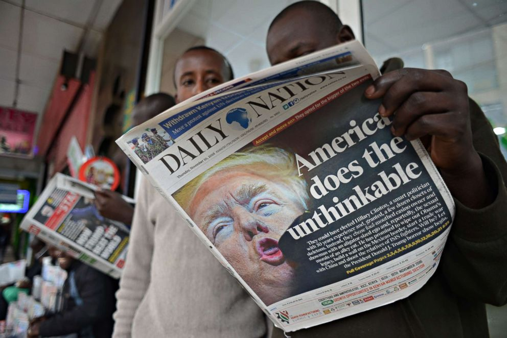 PHOTO: People read a Kenyan newspaper showing newly elected U.S. President Donald Trump in Nairobi on Nov. 10, 2016.