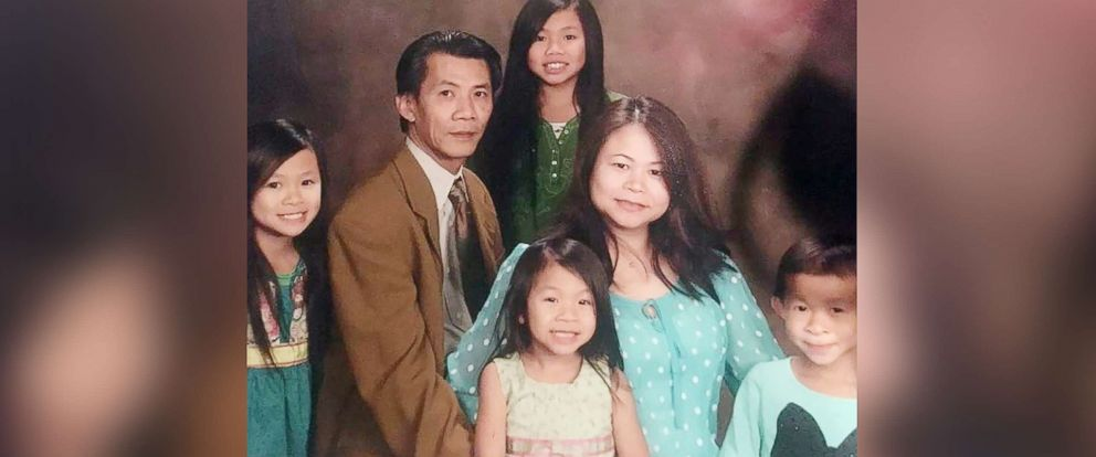 PHOTO: Michael Nguyen, a 54-year old American father of four missing in Vietnam, is seen here with his family in an undated photo.