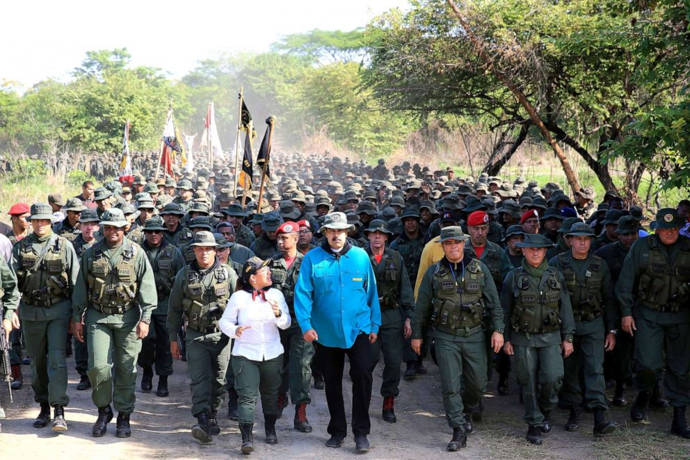 PHOTO: Handout photo released by the Venezuelan Presidency of Venezuelas President Nicolas Maduro (center) during military exercises of cadets of the Bolivarian Military University at a training center in El Pao, Cojedes state, Venezuela, May 4, 2019.