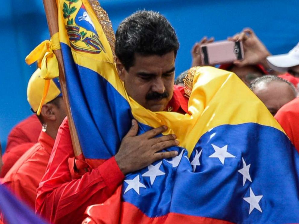 PHOTO: Venezuelan President Nicolas Maduro holds a national flag during the closing of the campaign to elect a Constituent Assembly that would rewrite the constitution, in Caracas, July 27, 2017.