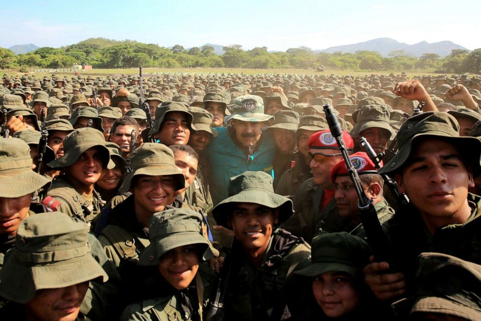 PHOTO: Venezuelas President Nicolas Maduro poses with soldiers during his visit to a military training center in El Pao, Venezuela, May 4, 2019.