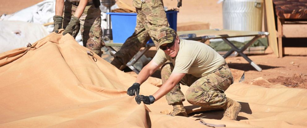 PHOTO: Airmen from the 724th Expeditionary Air Base Squadron to work together to tear down tents from the old base to move to their new location, Sept. 11, 2017, at Air Base 201, in Agadez, Niger.