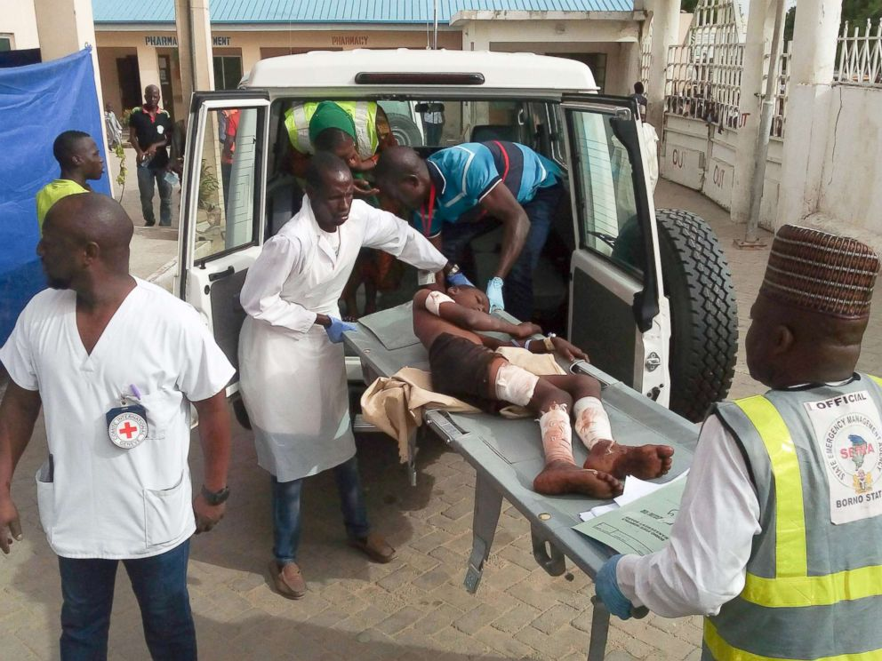 Audu Marte  AFP  Getty Images Paramedics carry a young victim of a blast at the hospital