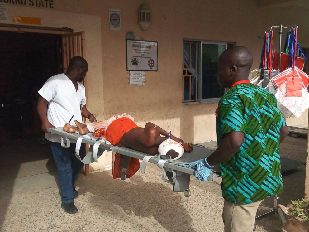 Audu Marte  AFP  Getty Images Paramedics stretcher a victim of a blast at the hospital in Maiduguri Nigeria