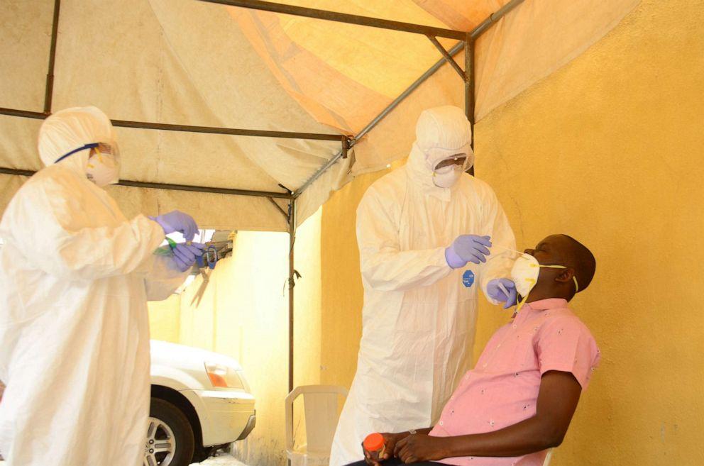 Health workers wait to takes a swab from a man during a community COVID-19 coronavirus testing campaign in Lagos, Nigeria, April 18, 2020.Olukayode Jaiyeola/NurPhoto via ZUMA Press via Newscom