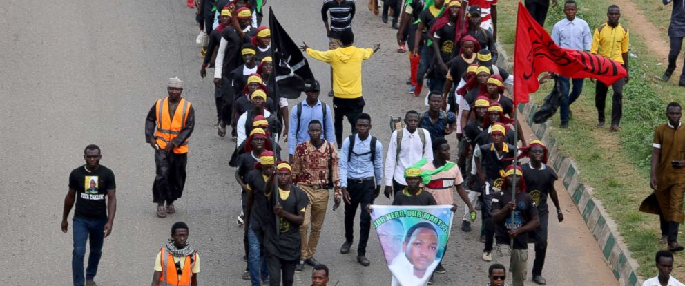 PHOTO: Members of Islamic Movement of Nigeria (IMN) wave flags and chant slogans as they take part in a demonstration to protest against an imprisoned Shiite cleric in Abuja, Oct. 29, 2018.