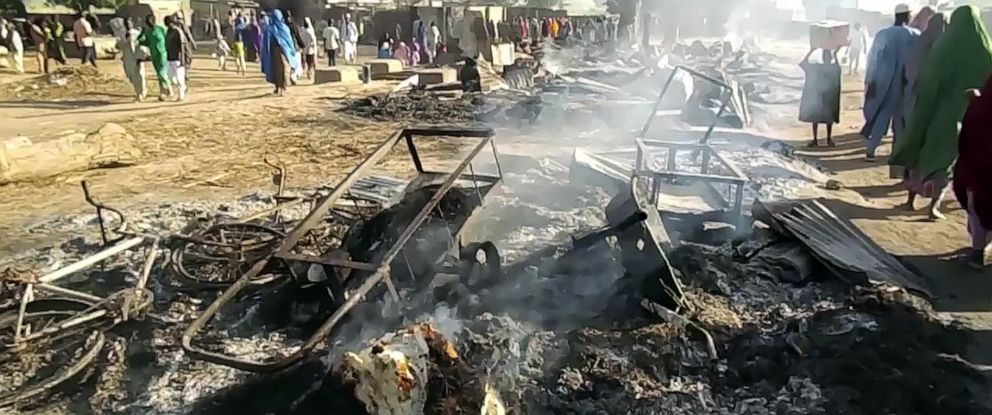 PHOTO: Smoldering ashes and charred items are seen on the ground in Budu near Maiduguri on July 28, 2019, after the latest attack by Boko Haram fighters on a funeral in northeast Nigeria has left 65 people dead.