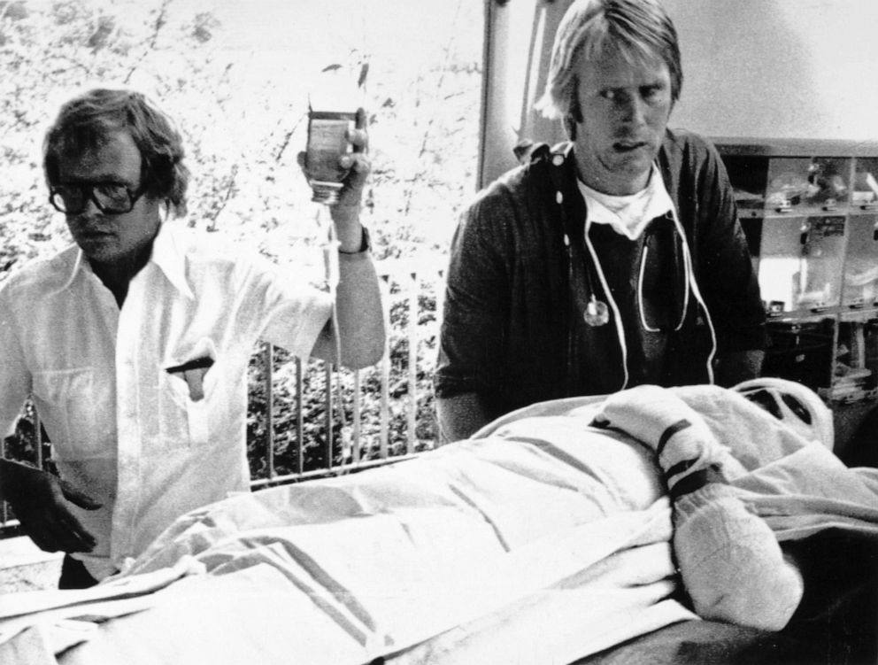PHOTO: Austrian Formula One driver Niki Lauda is carried into the hospital at Ludwigshaven after suffering serious burns when his Ferrari caught fire during the German Grand Prix, Aug. 1, 1976.