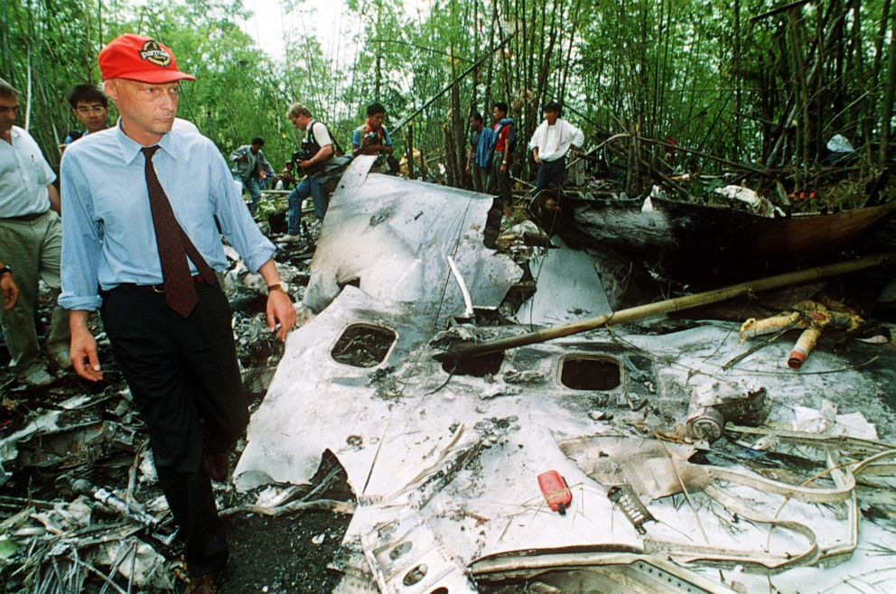 PHOTO: On the day after the crash, Niki Lauda walks through the debris of a Lauda Air Boeing 767 airliner which exploded over a remote jungle area of Thailand on May 26, 1991.