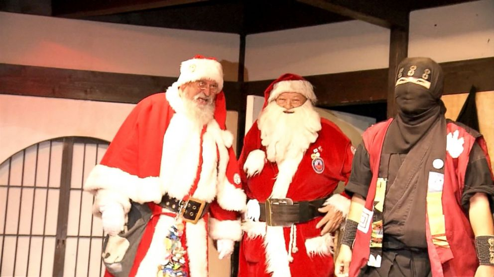 PHOTO: A pair of Santas getting ninja training in Japan.