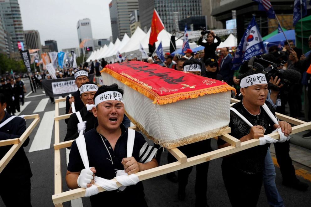PHOTO: People carrying mock coffins of a 42-year-old defector mother and her 6-year-old son who were found dead of starvation in Seoul, South Korea, Sept. 21, 2019.