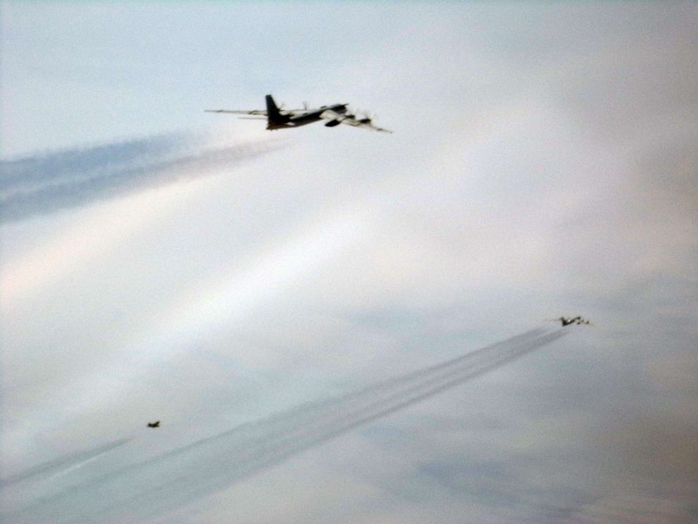 Tu-95 bomber is intercepted by a U.S. Air Force F-22 Raptor off the coast of Alaska