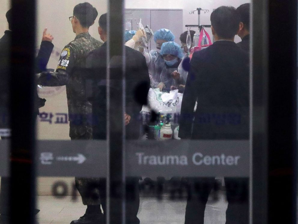 PHOTO: A South Korean military officer looks on as medical members treat an unidentified injured person, believed to be a North Korean soldier who defected, at a hospital in Suwon, South Korea, Nov. 13, 2017.
