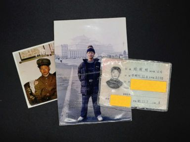 PHOTO: Photographs and North Korean identification card owned by Lee Oui-ryuk are seen in Seoul, South Korea, Sept. 12, 2017.