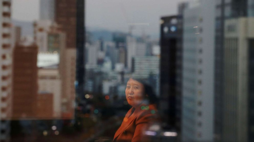 PHOTO: Kim Ryon Hui, 48, is reflected on a window as she poses for a photograph in Seoul, South Korea, Nov. 14, 2017.