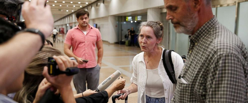 PHOTO: Aid workers Heidi Linton (2nd R) and Rob Robinson (R) of Christian Friends of Korea talk to the media after their arrival from Pyongyang at Beijing airport, China, Aug. 31, 2017.