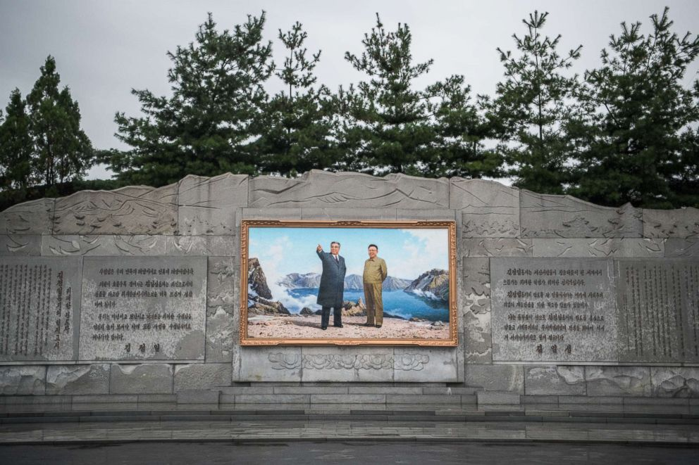 PHOTO: A picture of Kim Il-sung and Kim Jong-il is displayed at the entrance to Mansudae Art Studio on Aug. 23, 2018 in Pyongyang, North Korea.