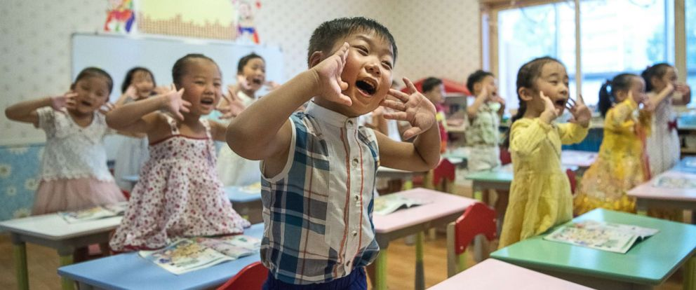 PHOTO: Children gesture and shout at the instruction of a teacher at Gyongsang Kindergarten on Aug. 23, 2018 in Pyongyang, North Korea.