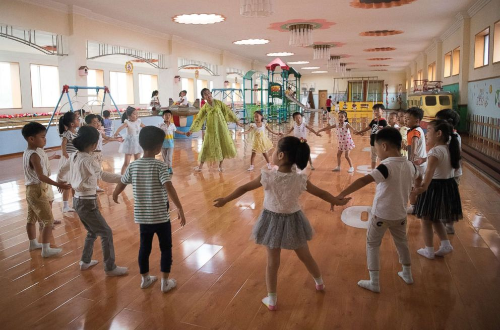 PHOTO: A teacher leads children in a play session at Gyongsang Kindergarten on Aug. 23, 2018 in Pyongyang, North Korea.