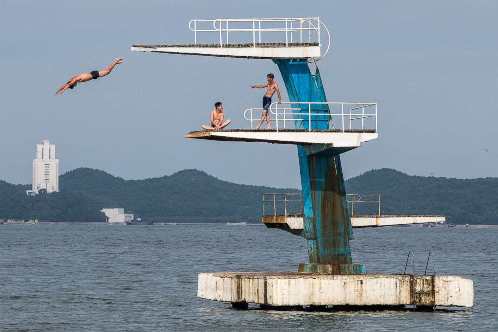 PHOTO: A man dives into the sea from a platform on Aug. 22, 2018 in Wonsan, North Korea.