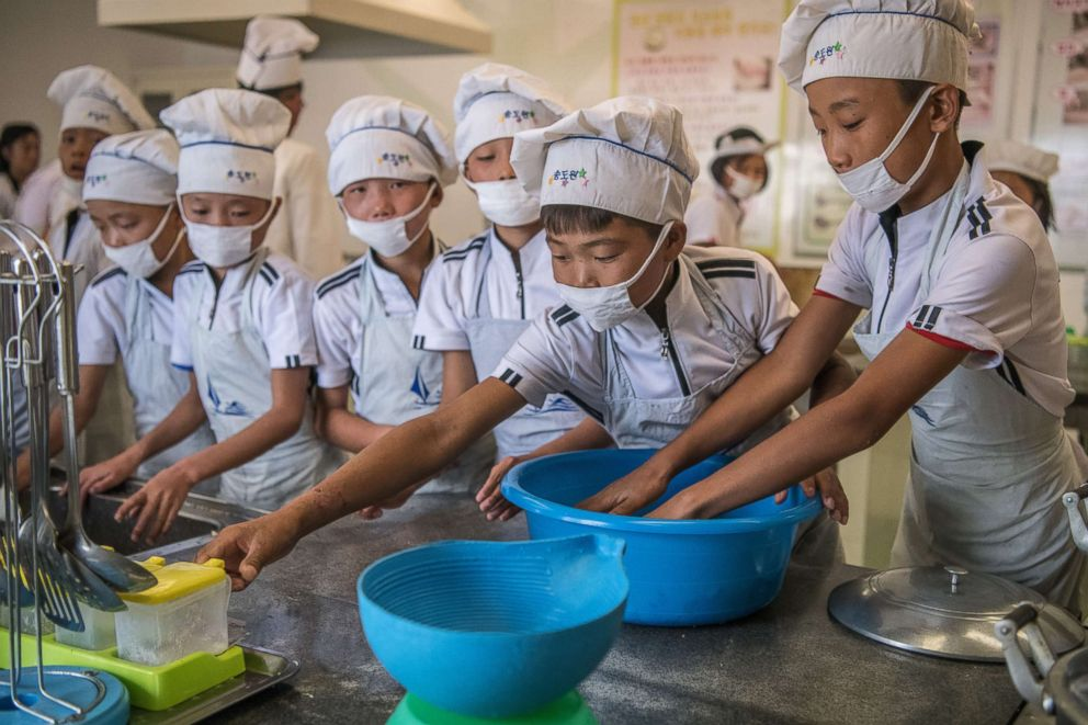PHOTO: Children take part in a cookery lesson at Songdowon International School Childrens Camp on Aug. 22, 2018 in Wonsan, North Korea.