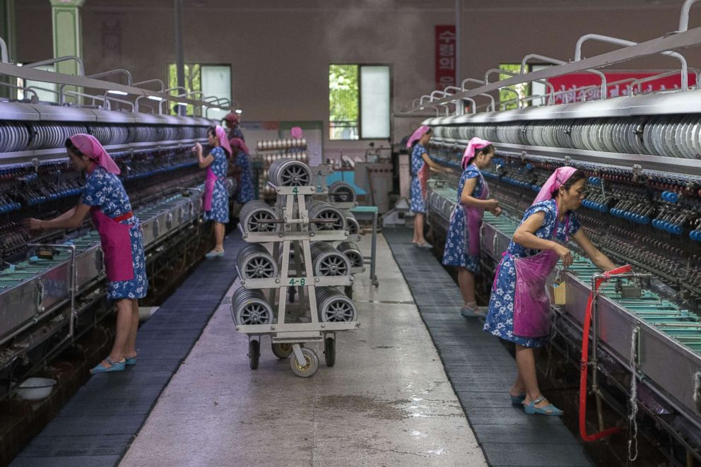 PHOTO: Women work in the Kim Jong Suk Silk Factory on Aug. 21, 2018 in Pyongyang, North Korea.