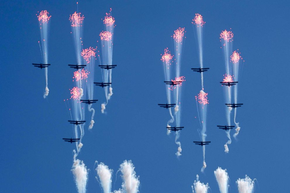PHOTO: Airplanes forming the number 70 fly in formation and fire flares during a parade for the 70th anniversary of North Koreas founding day in Pyongyang, North Korea, Sept. 9, 2018.