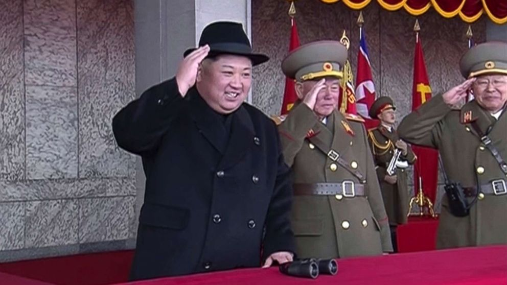 In this image made from video by North Korea's KRT, North Korean leader Kim Jong Un, center, attends a military parade in Pyongyang, North Korea, Feb. 8, 2018. North Korea held a massive military parade highlighted by intercontinental ballistic missiles in its capital on Thursday, just one day before South Korea hosts the opening ceremony of the Pyeongchang Winter Olympics.